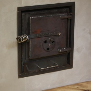 lämpimämpi stove mounted in firewall